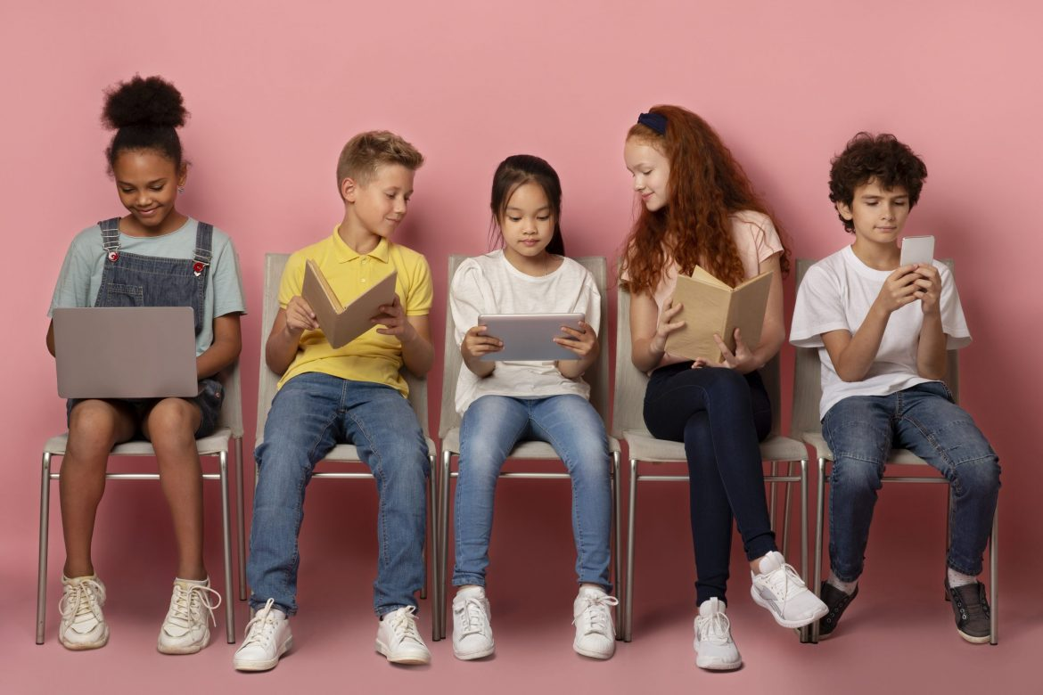 Elearning concept. Diverse schoolchildren using tablet, laptop, smartphone and books to study online on chairs over pink background